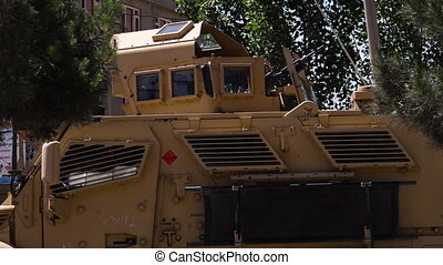 A parked armored car in Kabul - A wide shot of an armored...