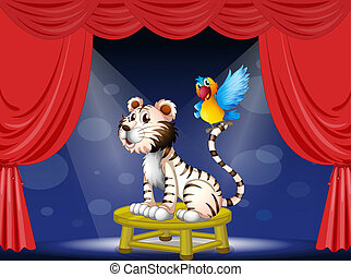 A parrot standing at the tail of a tiger