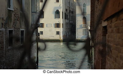 A part of a Venice area being seen through the openwork...