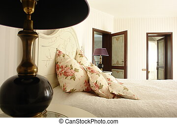 A part of bed and lamp