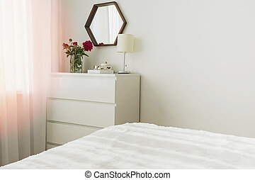 A part of modern bedroom in white colors