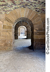 A passageway with round arches