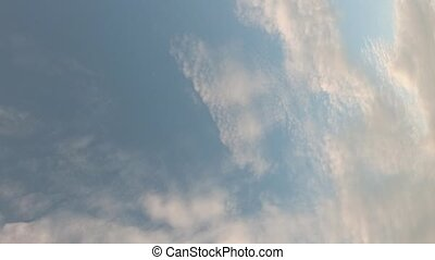 A passenger airliner flies in the sky. Sky time lapse, airplane fly by. Beautiful Universally Cloudscape background. Vertical video.