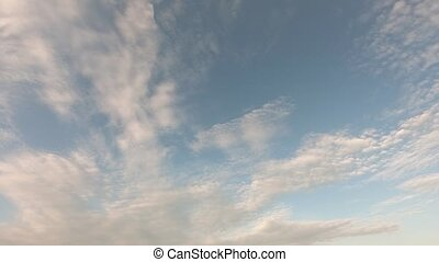 A passenger airliner flies in the sky. Sky time lapse, airplane fly by. Beautiful Universally Cloudscape background.