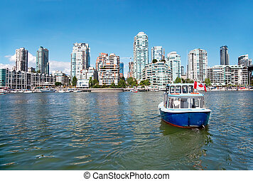 A passenger ferry is commuting between Granville Island and...