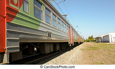 A passenger train on the railway on a Sunny day