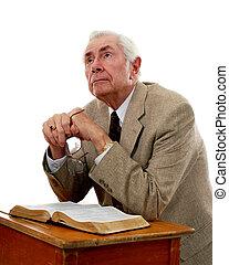 A Pastor\\\'s Heart - A senior man kneeling at an old school...