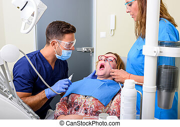 A patient getting attended and treatment in a dental studio