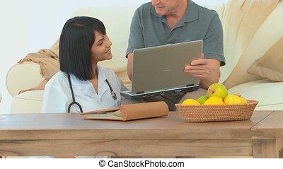 A patient using a laptop