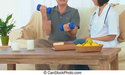 A patient using dumbbells