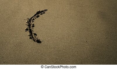 A peace symbol in the sand