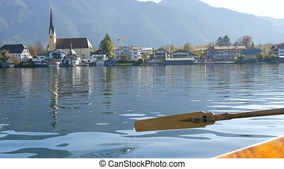 A peaceful picture a wooden boat with an oar floats on ...