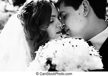 A peacefull moment before a kiss between newlyweds