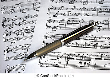 A pen on the top of music sheets