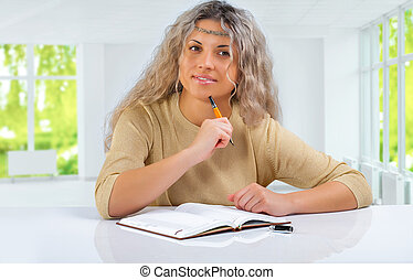 a pensive smiling girl at the table