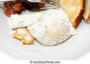 A Peppered Over Easy Fried Egg