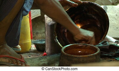 A person cleaning a bowl - An extreme close up shot of the...