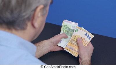 A person counting euro banknotes, European union money , cash money calculation