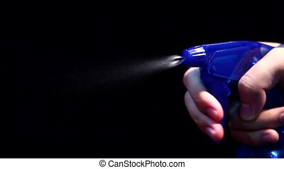 A person hand held pump sprayer on Black Background with...