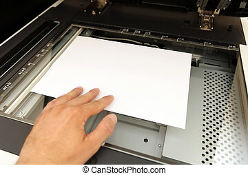 A person handling with working laser copier