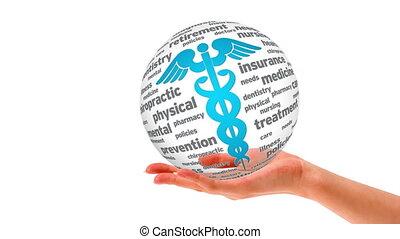 A person holding a 3D Caduceus Sphere