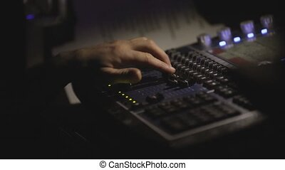 A person is working behind the control panel.