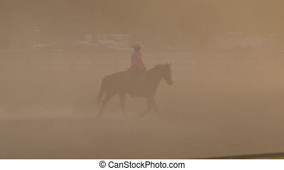 A person riding a horse in a ranch - A hand held wide shot...