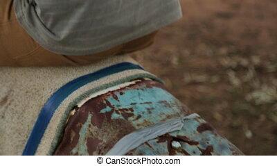 A person rocking a rusty metal - A still close up shot of a...