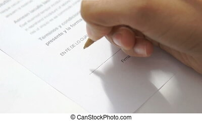 Signing an Agreement - A person Signing an Agreement