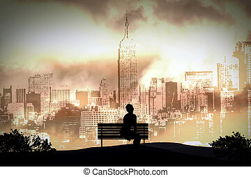 alone - A person sitting alone on a bench in New York