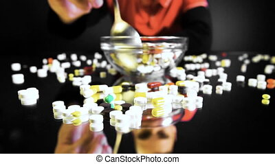 A person sitting in front of a bowl with pills is going to eat like a meal