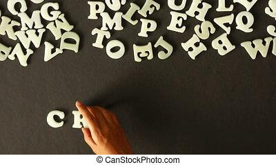 A person spelling Creativity