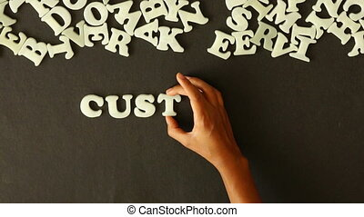 Customer Focused - A person spelling Customer Focused with...