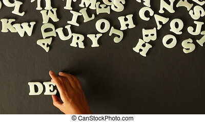 A person spelling Development