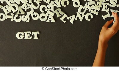 Get Started Today - A person spelling Get Started Today with...