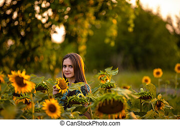 A person standing in front of a flower