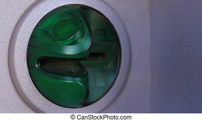 A person's hand takes credit card out of the ATM. Close-Up video