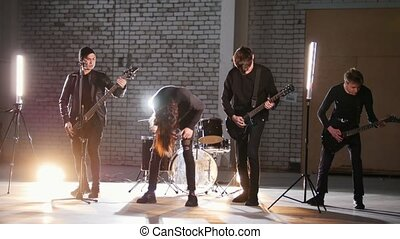 A perspective rock group having a repetition. Mid shot