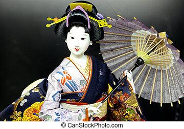 geisha doll - A photo of a geisha doll in japan