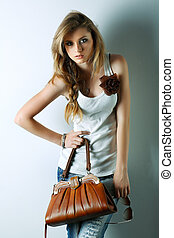 A photo of beautiful girl is in fashion style