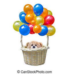 Teddy bear sitting in the basket