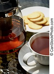 A photo series illustrating a tea break. Tea served with biscuits as the meal.  Taken in outdoor and indoor environment. Great images for food and beverages and can also serve as illustration for rela