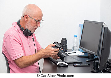 photographer and camera at office with computer