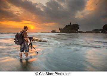 A Photographer photographing sunset at Tanah Lot, Uluwatu, Bali