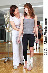 Physiotherapist and patient with foot injury