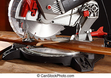 mitre saw - A pice of wood in a mitre saw