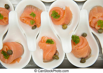 pickled Salmon roll in white spoon