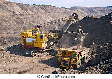 A picture of a big yellow mining truck at worksite