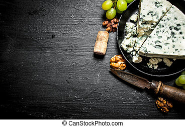 piece of blue cheese, walnuts and white grapes.