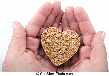 A piece of bread offered with love - isolated on white
